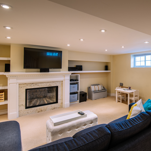 Modern finished living room in basement